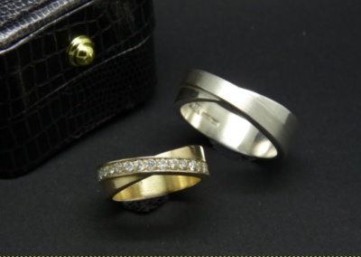 This beautiful set of wedding rings were a private commission.  The brides ring, in 14ct yellow gold is set with 15 diamonds and the groom's ring echos the design perfectly in Sterling Silver.
