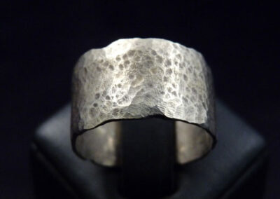 9ct yellow gold ring with distressed edges and a beaten, aged finish.  Every ring is unique and can be made in any width from 4mm-12mm, in any carat and colour of gold as well as silver, lightweight or heavyweight.  From £105.00 in silver, £365.00 in 9ct yellow gold (wb-05)