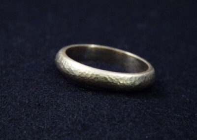 Classic and ageless...this has to be the perfect wedding ring.  Softly hammered for a lightly aged 'roman' finish, this d-shaped wedding band is available in any width from 3mm-12mm and is made to order in your choice of sterling silver, 9ct or 18ct gold.  From £330.00 in 9ct yellow gold, please contact me for prices in alternative metals (ref. wbg-04)