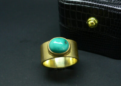 Striking and bold, this beautiful turquoise cabochon is perfectly complemented in buttery 18ct yellow gold with a soft satin finish.  From £2,095.00 in 18ct gold, please enquire for other metal options (ref. gsrt-02)