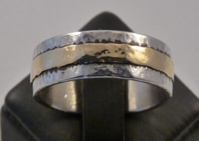 9ct white gold wedding band overlaid with an 18ct yellow gold band.  Softly hammered & polished finish.  Available in any combination of metals - silver, white & yellow gold.  As pictured in 9/18ct gold from £915.00 (ref. wbm-03)
