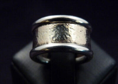 9ct yellow gold, softly hammered for an aged finish, with 9ct white gold round wire caps, highly polished for contrast.  From £395.00 (ref. wbm-01)